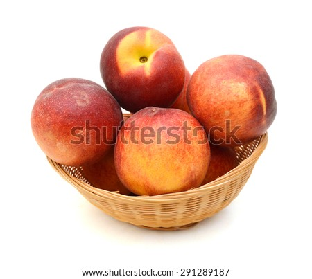 Ripe peach fruit isolated in basket on white background - stock photo