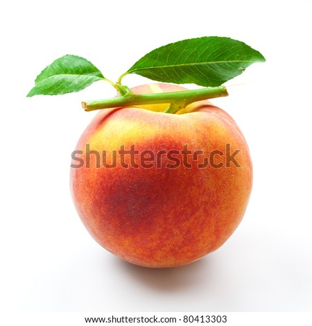 ripe peach fruits with green leaves isolated on white background - stock photo