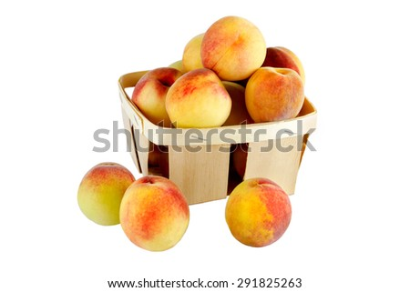 Ripe peaches in a wicker basket, isolated on white background - stock photo