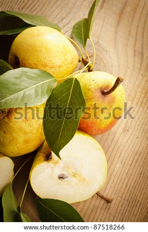 Ripe pears closeup on wooden table - stock photo