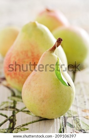 Ripe pears on a beautiful wooden table . - stock photo