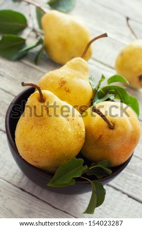 Ripe pears over wood table - stock photo