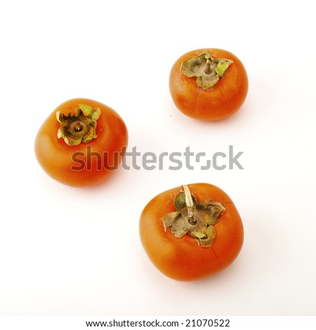 Ripe persimmon on a white background - stock photo