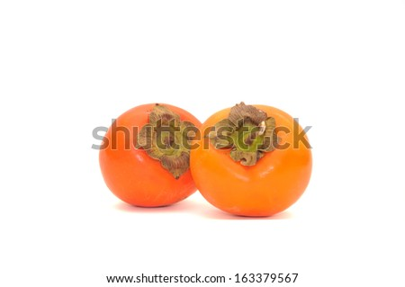 ripe persimmons - stock photo
