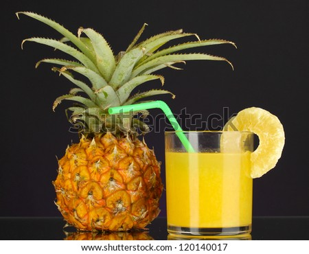 Ripe pineapple and juice glass isolated on black - stock photo