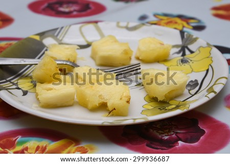 Ripe pineapple fruit isolated. Fresh cut pineapple slices Kerala India - stock photo