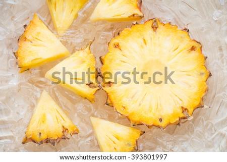 Ripe pineapple slices on ice  - stock photo