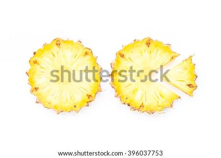 Ripe pineapple slices on white background - stock photo