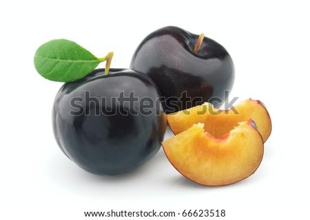 Ripe plum on a white background - stock photo