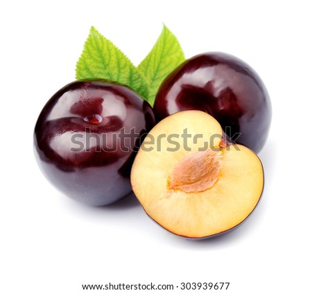 Ripe plums with leaves close up on white background.  - stock photo