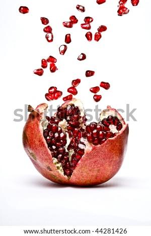 Ripe Pomegranate fruit, opened - stock photo