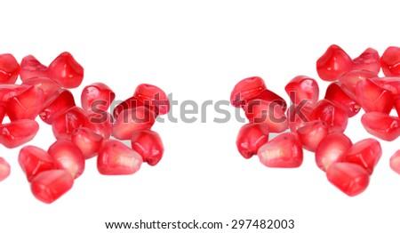 ripe pomegranate seeds isolated on white background - stock photo