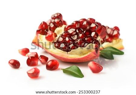 Ripe pomegranate with leafs close-up isolated on white - stock photo