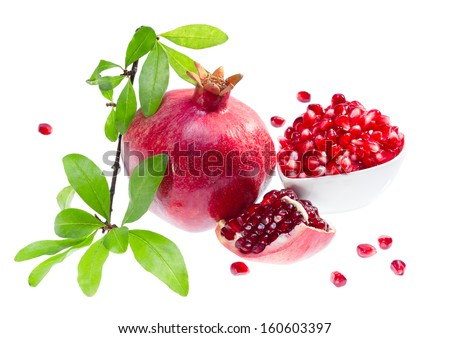 Ripe pomegranate with the branch isolated on white background. - stock photo