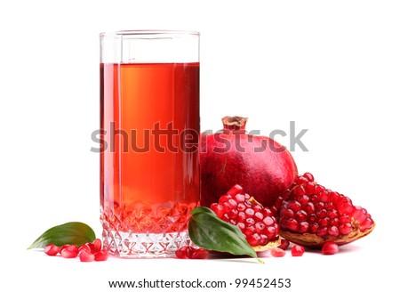 ripe pomergranate and glass of juice isolated on white - stock photo