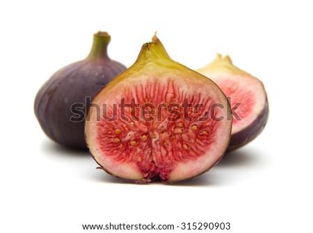 ripe purple figs isolated on white background - stock photo