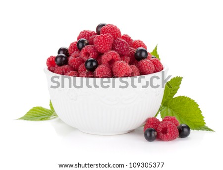 Ripe raspberries and currants. Isolated on white background - stock photo