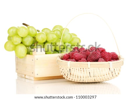 ripe raspberries and grapes isolated on white - stock photo