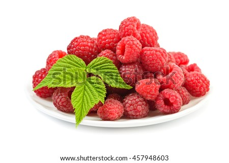 Ripe raspberry with leaf at plate on white background - stock photo