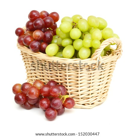 Ripe red and green grapes isolated in basket on white  - stock photo