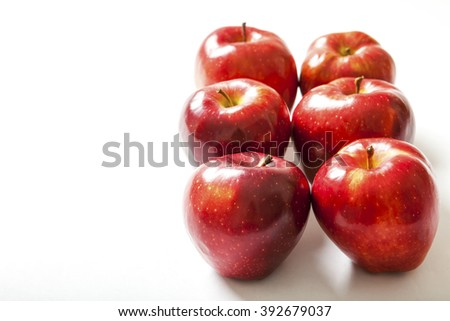 Ripe red apple. Isolated on a white background. - stock photo