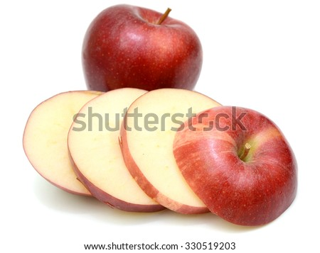 Ripe red apple slices Isolated on white background - stock photo