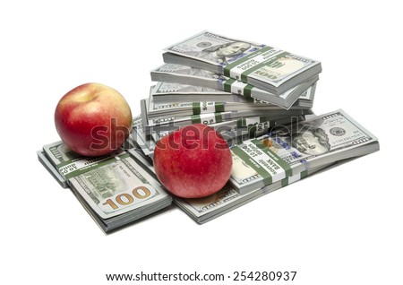 Ripe red apples on stacks of dollar bills  - stock photo