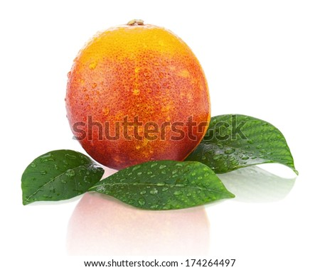 Ripe red blood oranges with green leaves isolated on white background. Closeup. - stock photo