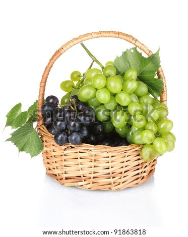 Ripe red grapes in basket isolated on white - stock photo