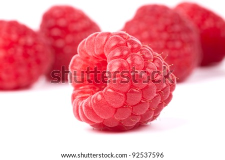 ripe red raspberry  on white background - stock photo