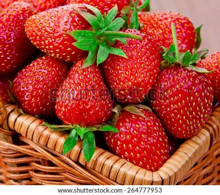Ripe red strawberries in a basket. close-up. - stock photo