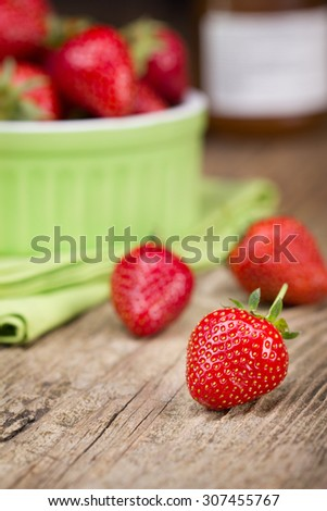 Ripe red strawberries on wooden table - stock photo