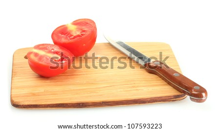 Ripe red tomatoes and knife on cutting board isolated on white - stock photo