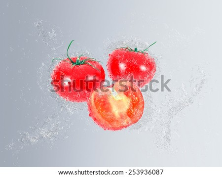 Ripe red tomatoes falling into fresh clean water with splash and bubble effect over a graduated grey background, whole and halved vegetables - stock photo