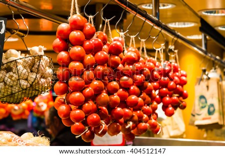 ripe red tomatoes on display at a market - stock photo