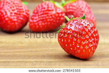 Ripe strawberries on wooden table. Fresh strawberries on wooden background - stock photo
