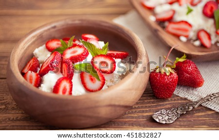 Ripe strawberry, cottage cheese. Farmer products. Food composition on a wooden background. Selective focus - stock photo
