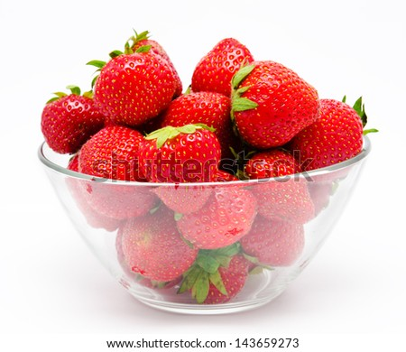 Ripe strawberry in the bowl isolated on white background - stock photo