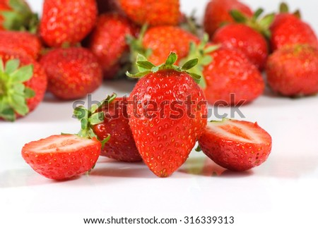ripe strawberry on a white background - stock photo