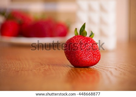 ripe strawberry on a wooden surface. fruit background - stock photo