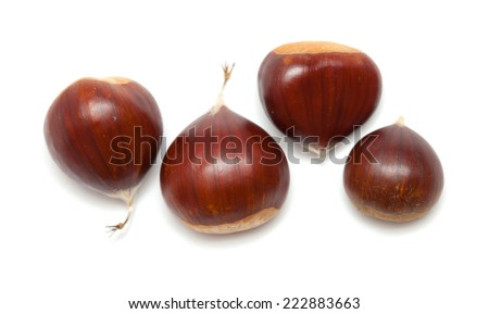 ripe sweet chestnuts isolated on white - stock photo