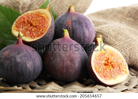 Ripe sweet figs with leaves, close up - stock photo