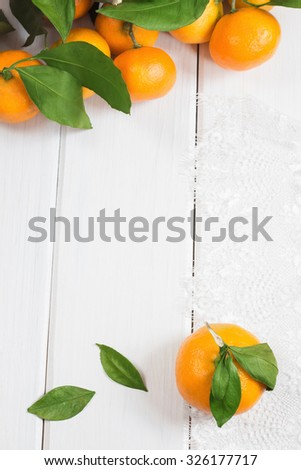 Ripe tangerines on white wooden background. Selective focus - stock photo