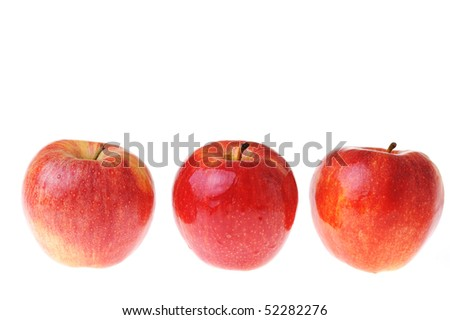 Ripe tasty red apples are isolated on white - stock photo