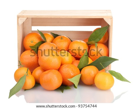 Ripe tasty tangerines with leaves in wooden box dropped isolated on white - stock photo