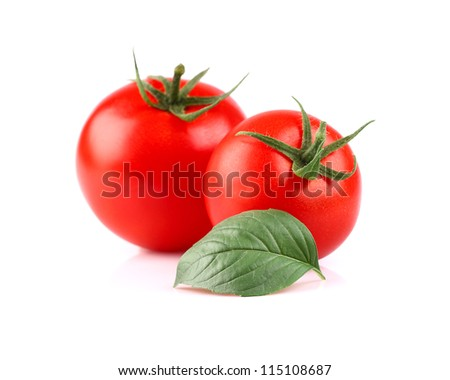 Ripe tomato with basil - stock photo