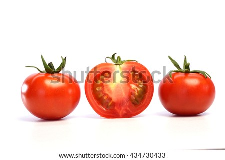 Ripe tomatoes in a row isolated on white background - stock photo