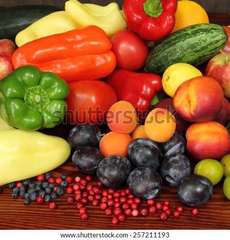 Ripe vegetables and fruits. Organic produce. Tomatoes,  plums, pepper, cowberries, zucchini, apples and other food. - stock photo