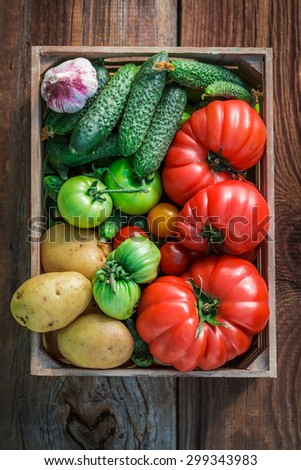 Ripe vegetables in wooden box - stock photo