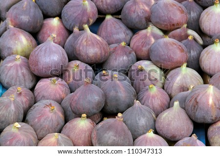 Ripe violet figs in blue box. - stock photo